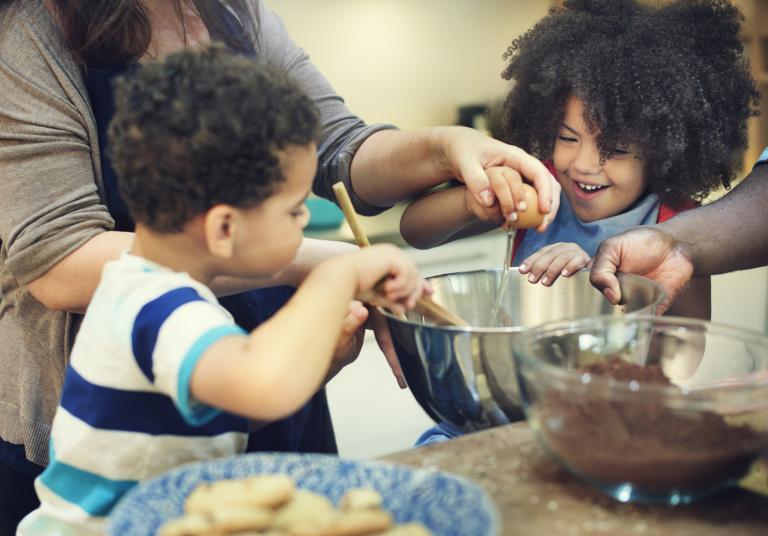 Kids helping to make cookies.